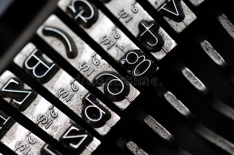 Old Typewriter. Closeup of letter and signs on old dusty typewriter stock images