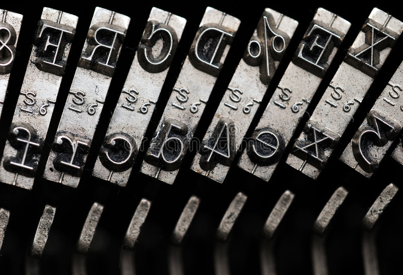 Old Typewriter. Closeup of letter and signs on old dusty typewriter royalty free stock photo