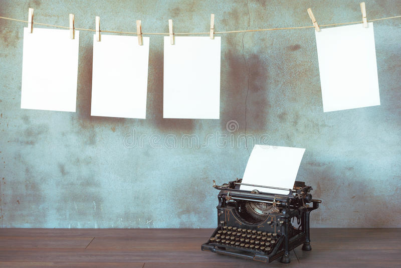Old typewriter. The old typewriter with a blank sheet of paper stock photo