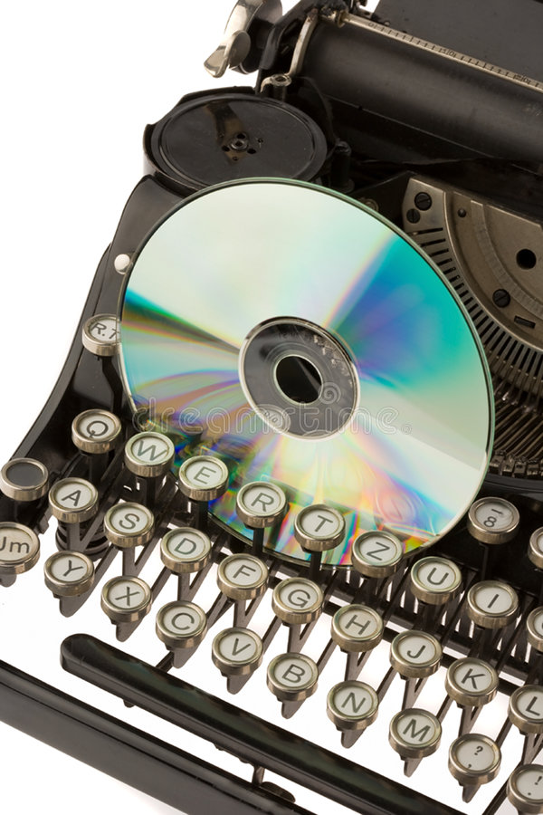 Old typewriter and CD. Keyboard of an old, black typewriter and a CD stock photography