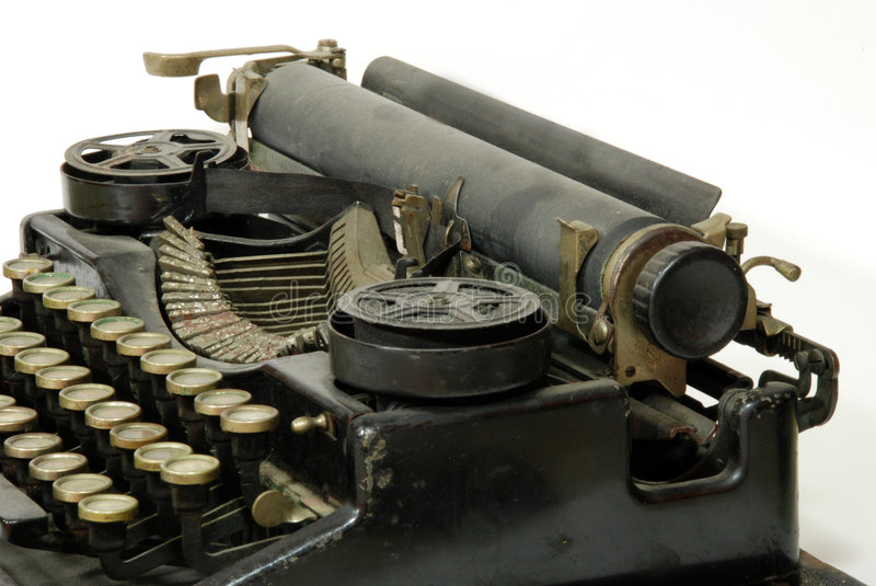 Old typewriter, detail. A typewriter is a mechanical or electromechanical device with a set of keys that, when pressed, cause characters to be printed on a stock photos