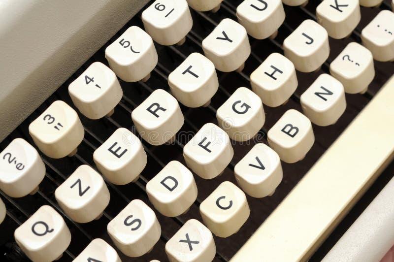 Old typewriter keys. Old typewriter white keys and black letters detail royalty free stock photos