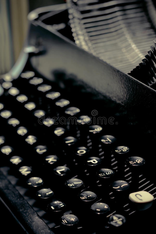 Old typewriter keys close up selective focus with retro colors