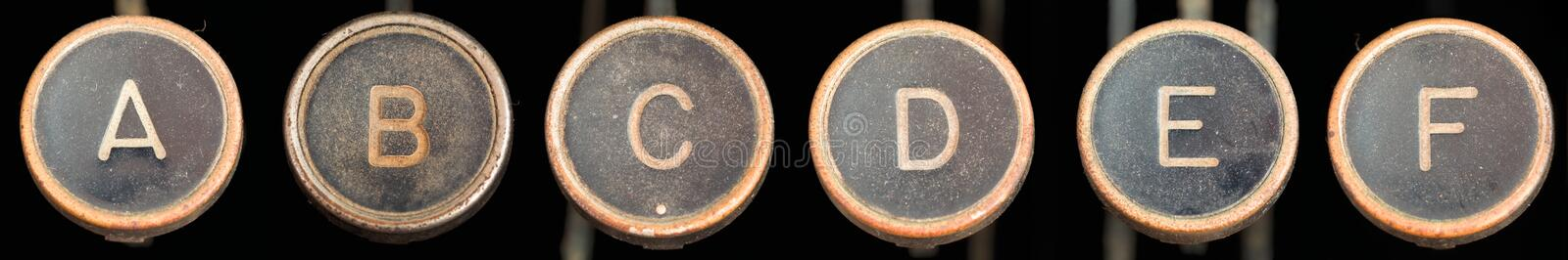 Old Typewriter Keys A-F. Covered in dirt and grime - A,B,C,D,E,F - 6 merged images stock photos