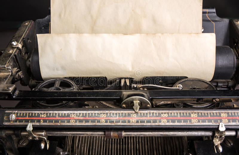 Old typewriter mechanism with inserted paper royalty free stock image