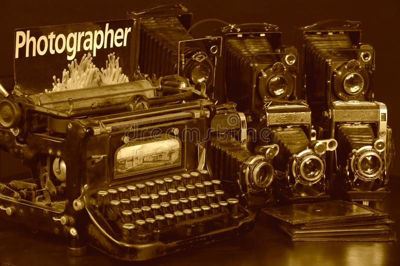 Old belonging of press-photographer. Old typewriter and old cameras for a press-photographer royalty free stock photos