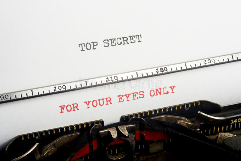 Top Secret Typewriter. An old typewriter still going with the word Top Secret and For Your Eyes Only just been typed. Copyspace royalty free stock images