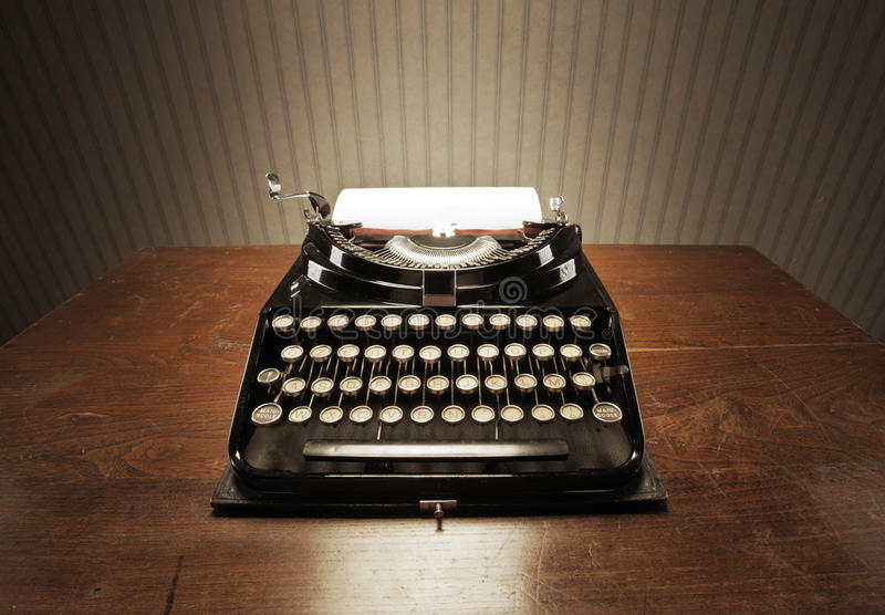 Old typewriter. On a wooden desk royalty free stock images