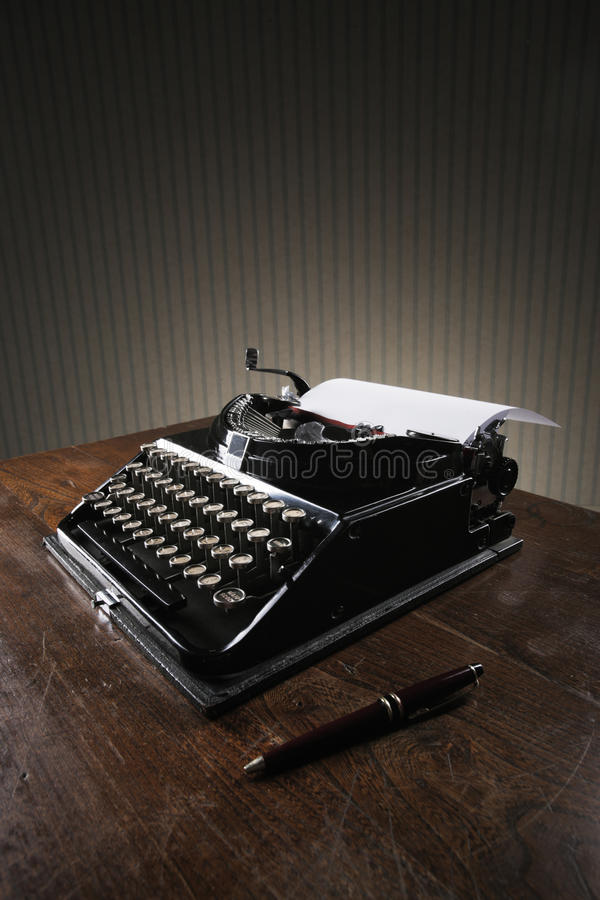 Old typewriter. On a wooden desk royalty free stock photo