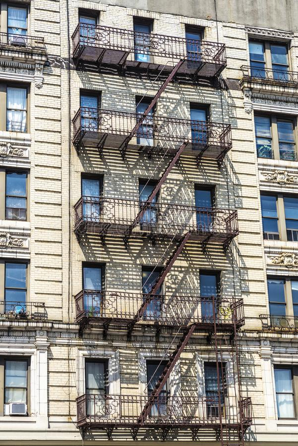 Old typical apartment buildings in Harlem, New York City, USA royalty free stock image