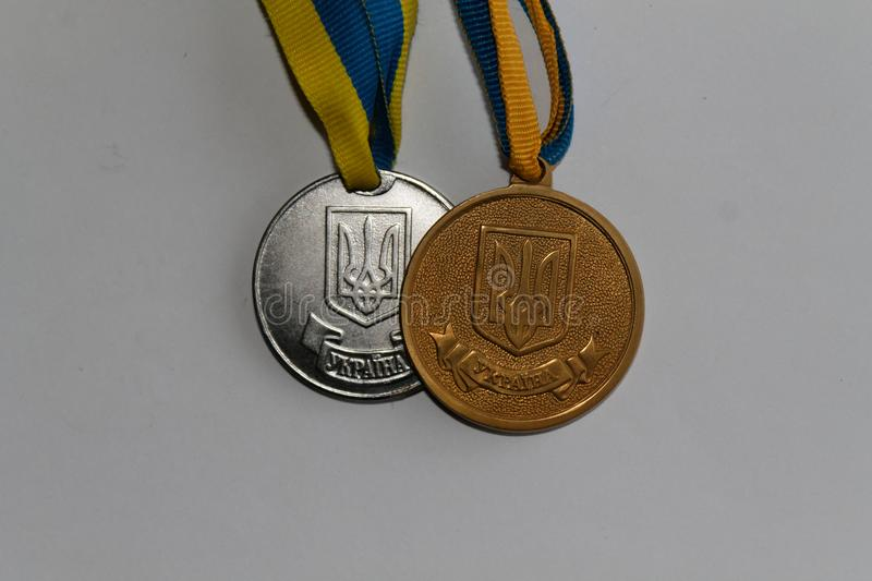 Old Ukraine gold and silver medals for excellence in high school graduation - back side.  stock image