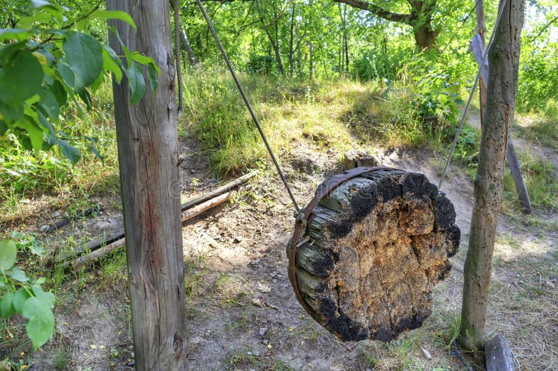 Old Ukrainian Cossack wooden shell for training on throwing knives, axes and arrows on a hill in the woods royalty free stock image