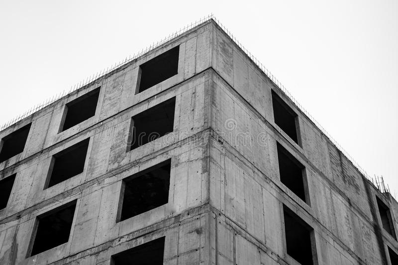 Old unfinished concrete building. Black and white photo royalty free stock images