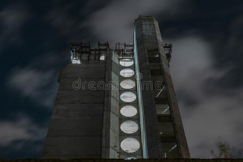 Old unfinished concrete hotel in city center . Kaunas. Lithuania. Old unfinished concrete hotel which was abandoned in the city center of Kaunas, Lithuania. Late royalty free stock image