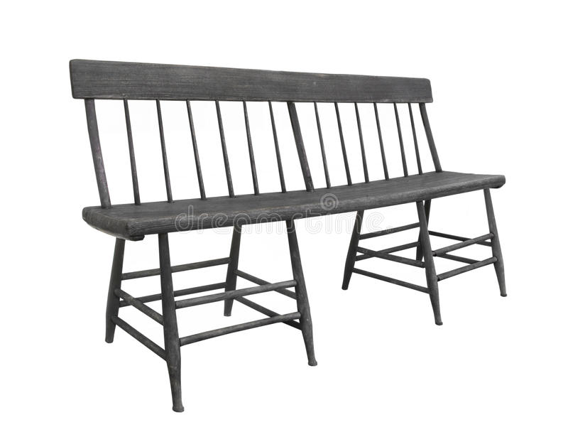 Old unique dark wood bench isolated. Old unique bench of dark wood made like two spindle leg chairs joined together. Isolated on white royalty free stock photo