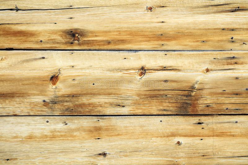 Old unique faded rough wood background. Unique bleached wood weathered background with copy space royalty free stock photography