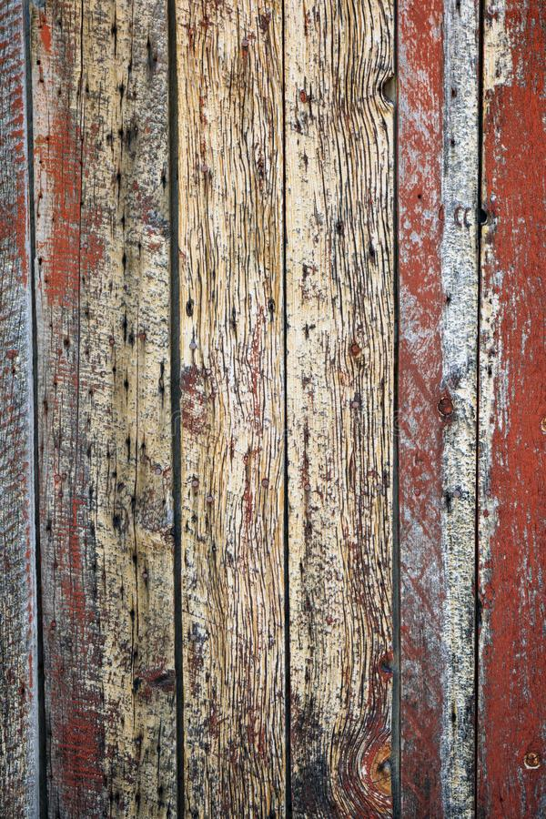 Old unique faded red wall background. Old unique vertical rust barn wood weathered background with copy space stock photography