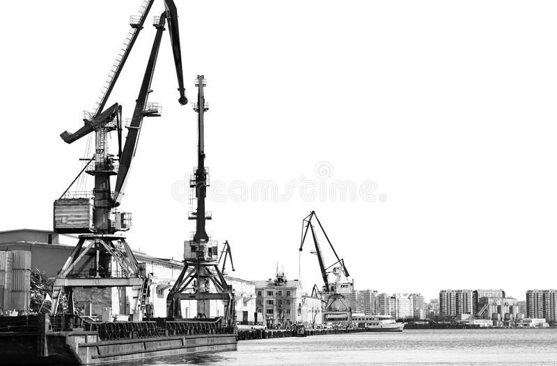 The old unloading cranes at the port. Contrasting black-and-white photo stock photo