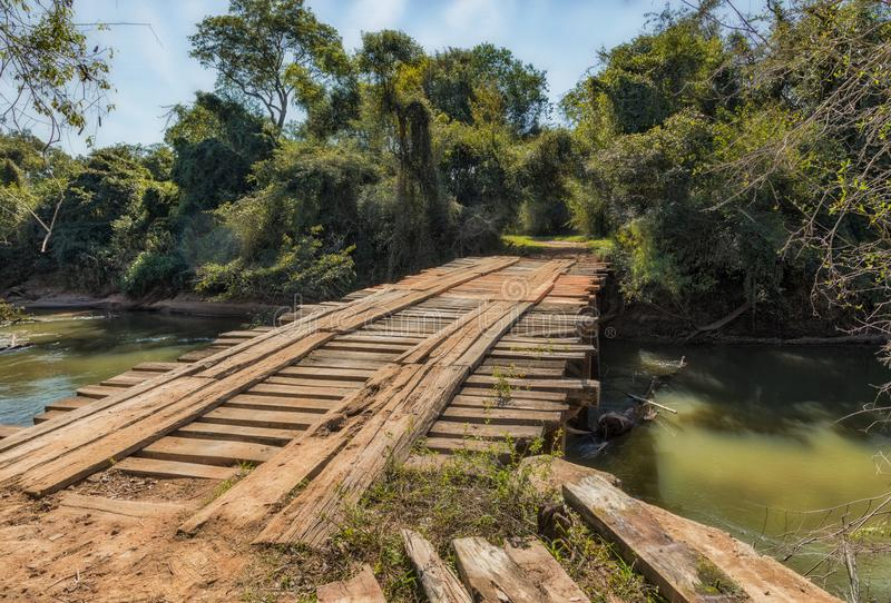 Old unsafe wooden bridge without railing in the wilderness of Paraguay. This is used by cars and even tractors royalty free stock images