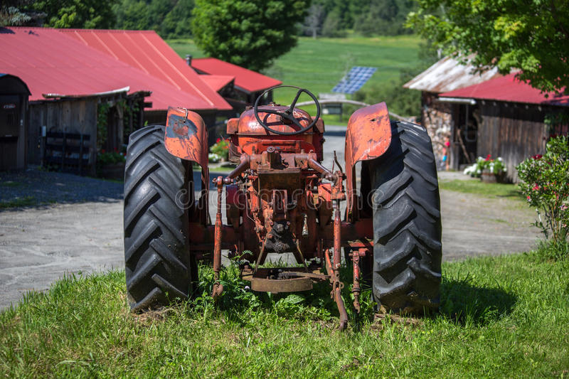 Old unused rusty tractor in a farm, USA royalty free stock images