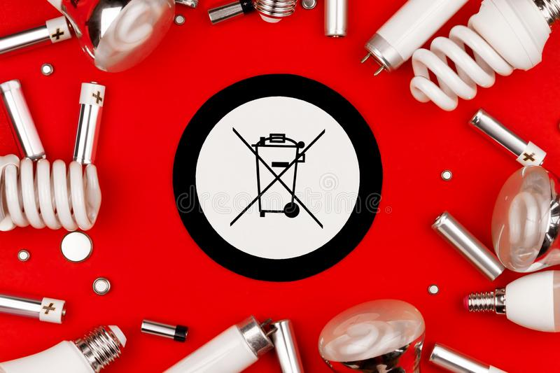 Old used batteries and light bulbs stock images