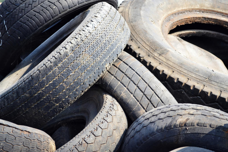 Old used car tires. A pile of old used rubber tires stock images