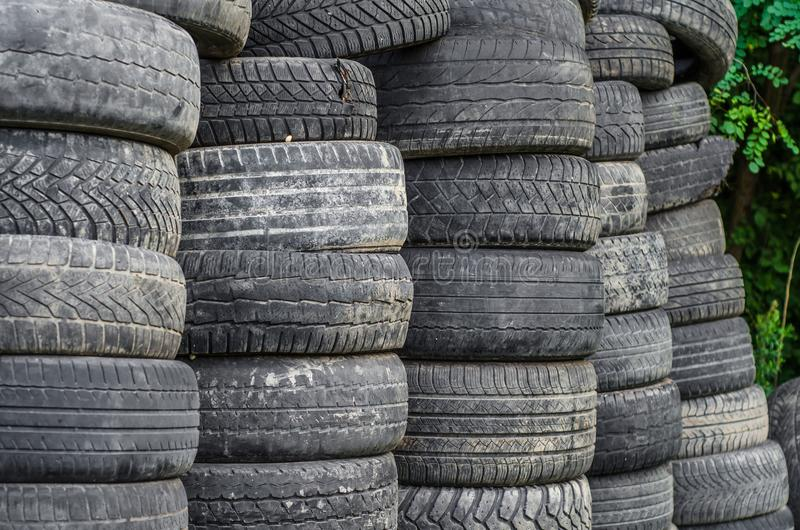 Old used car tires stacked in stacks stock photos