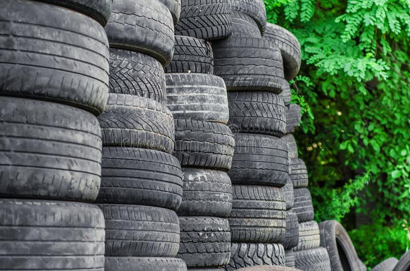Old used car tires stacked in stacks royalty free stock photos