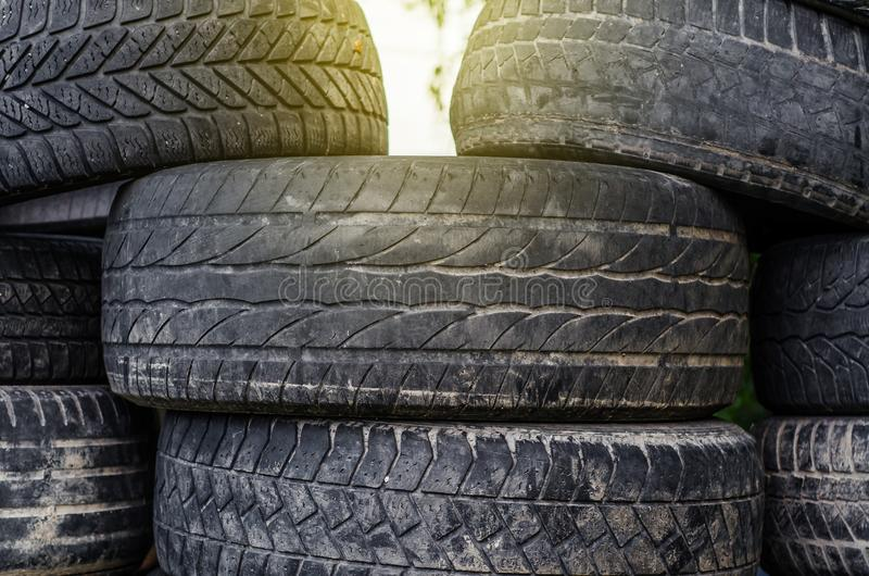 Old used car tires stacked in stacks royalty free stock photography
