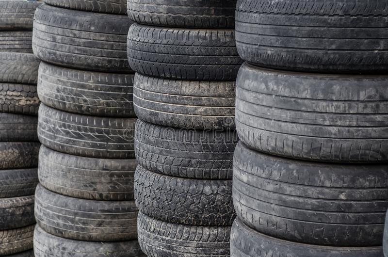 Old used car tires stacked in stacks stock photography