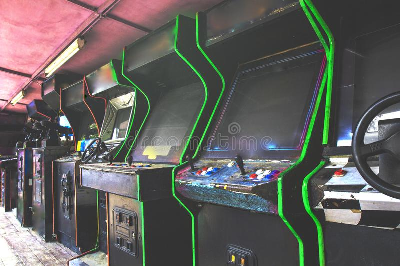 Old used classic forgotten Vintage Arcade in room and none of players playing video games in the frame. Game machine cabinet with royalty free stock images