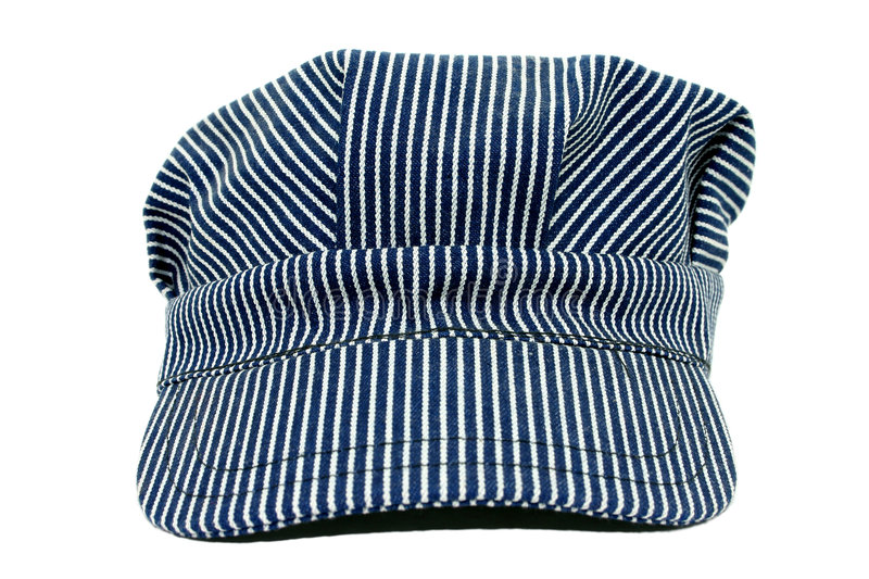 Old Used Conductors Hat. Blue and white striped conductors hat. Used royalty free stock image