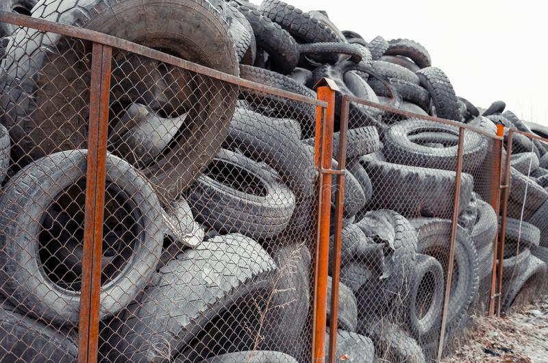 Old used damaged car tires at the dump royalty free stock photos