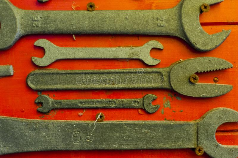 English keys on red background. Old and used english keys on red background royalty free stock image