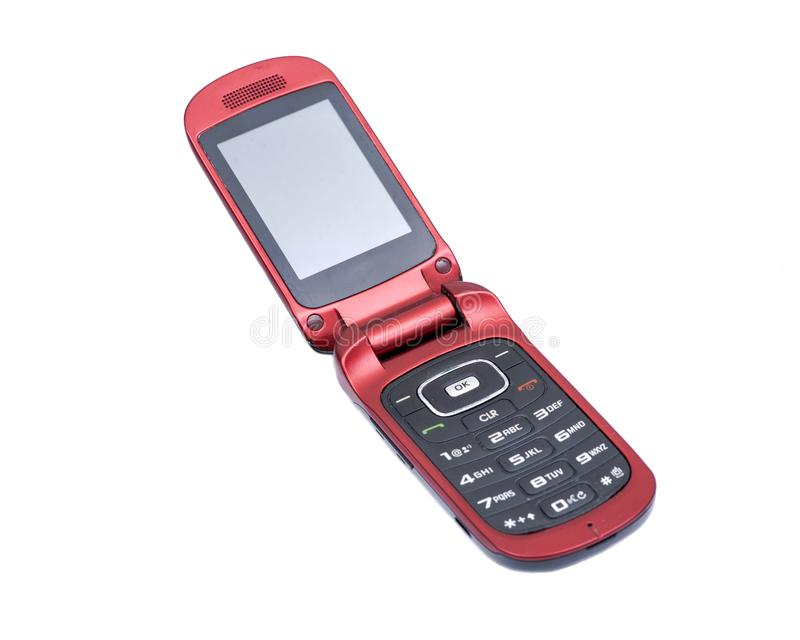 Old used flip cell phone isolated on white stock photos