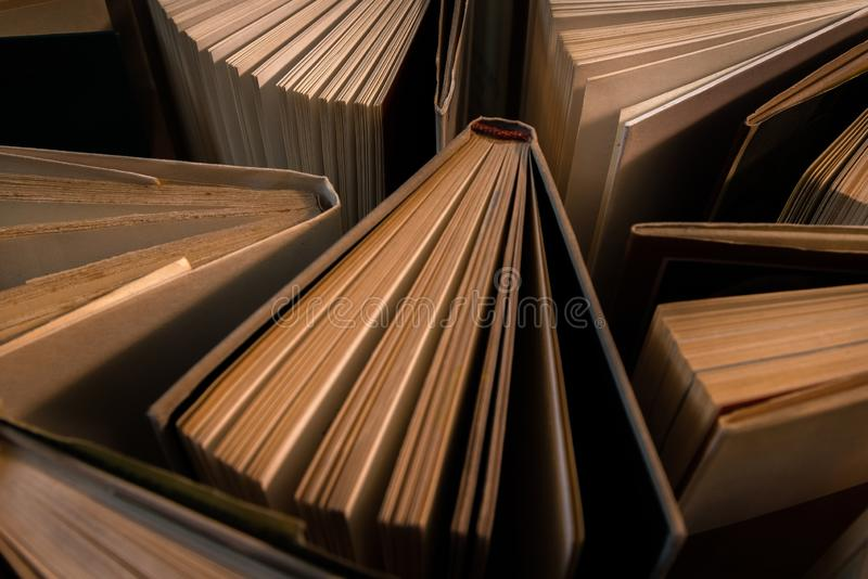 Old and used hardback books, text books seen from above on wooden floor. Books and reading are essential for self improvement, ga. Ining knowledge and success in stock images