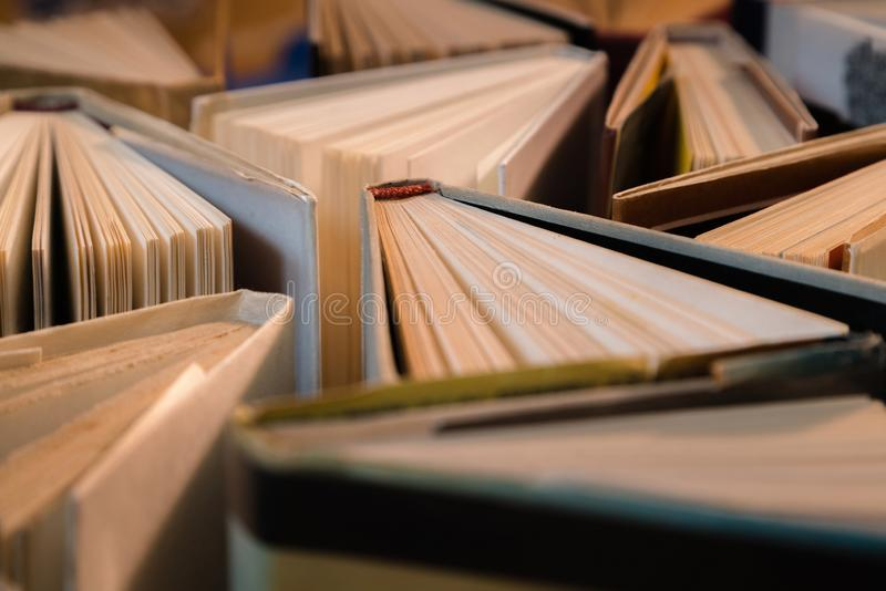 Old and used hardback books, text books seen from above on wooden floor. Books and reading are essential for self improvement, ga. Ining knowledge and success in royalty free stock image