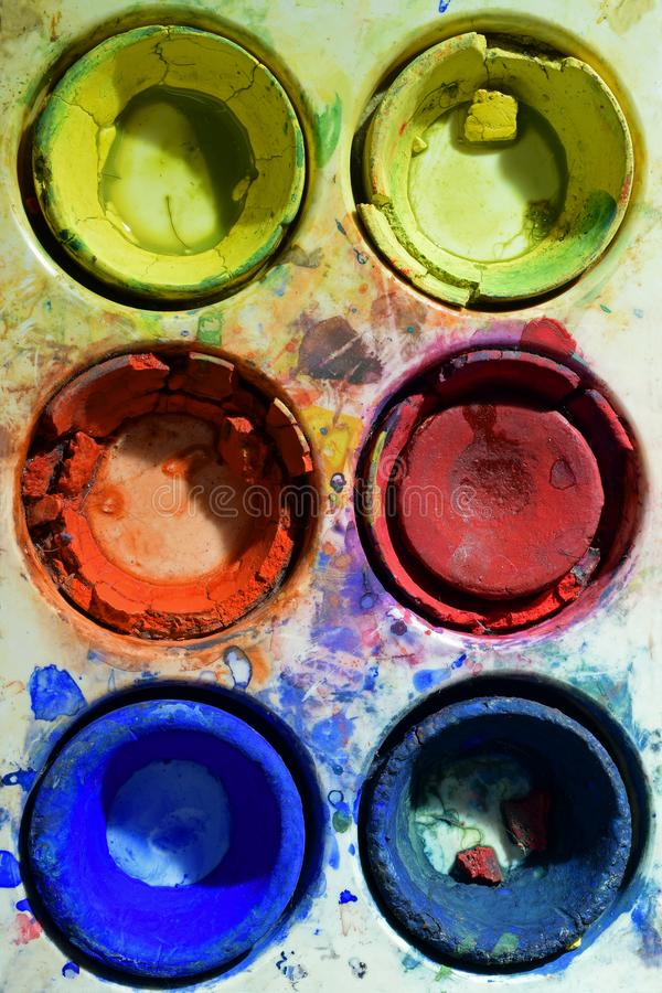 Old used primary colors water color paint box stock photo