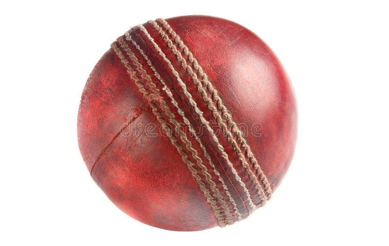 An old used red cricket ball. An old used red cricket ball, isolated on a white background stock photo