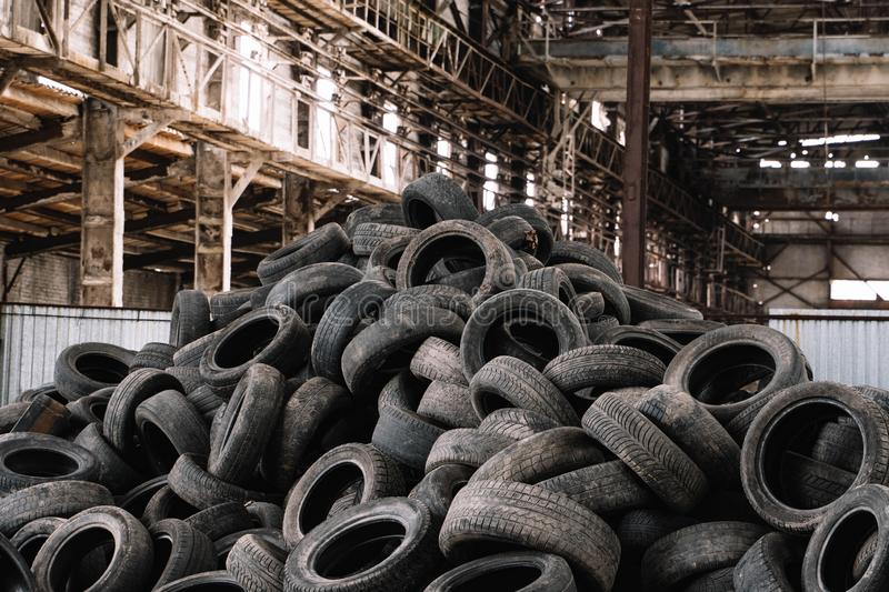 Old used tires stacked with high piles stock images