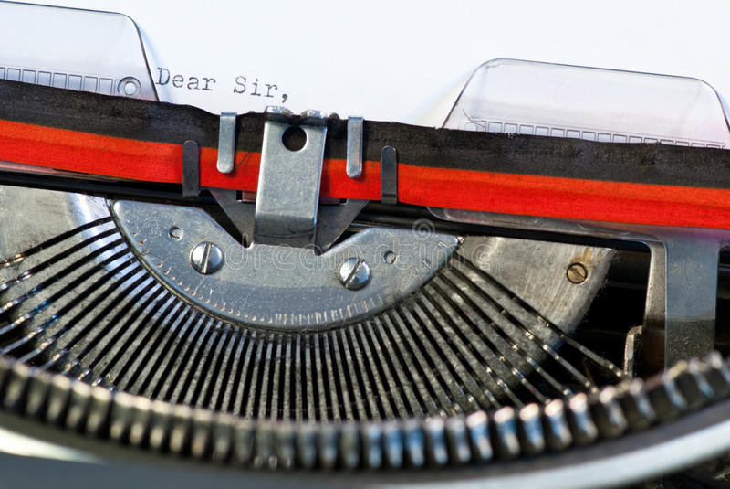 Typewriter. Old used typewriter with paper royalty free stock image