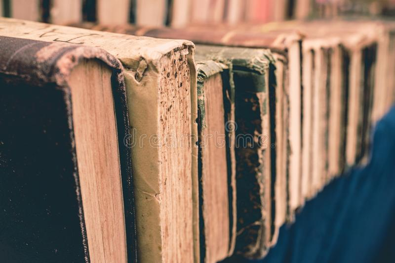 Old used vintage books with colorful leather covers lay on market in Italy. Close up. stock images