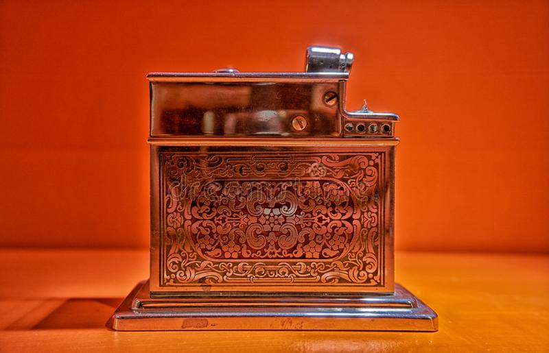 Old Used vintage Silver metal lighter red background smoker zippo light open burn one used tobacco macro equipment wheel object royalty free stock images