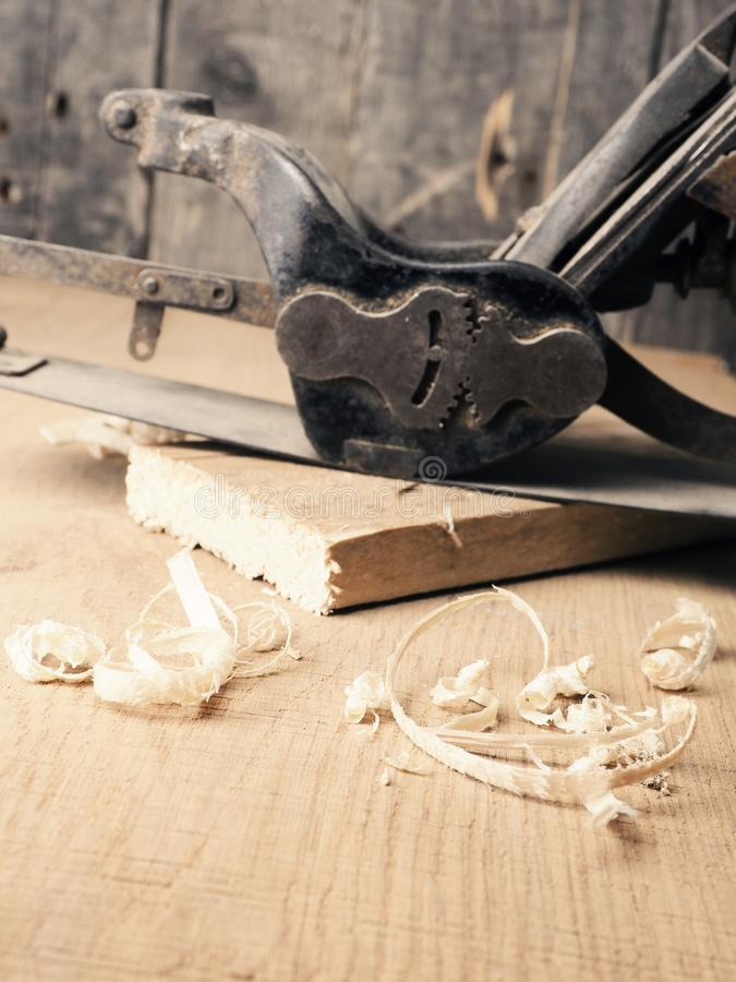 Old used wood plane on work bench stock photos