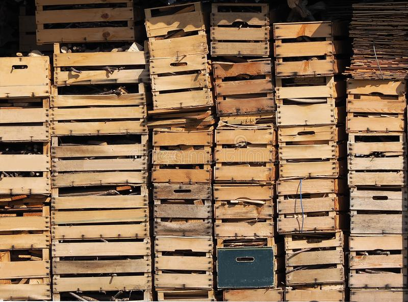 Old and used wooden boxes stacked on top of each other. royalty free stock photos