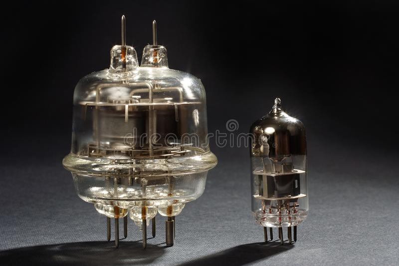 Old vacuum tubes on black. Background royalty free stock photo