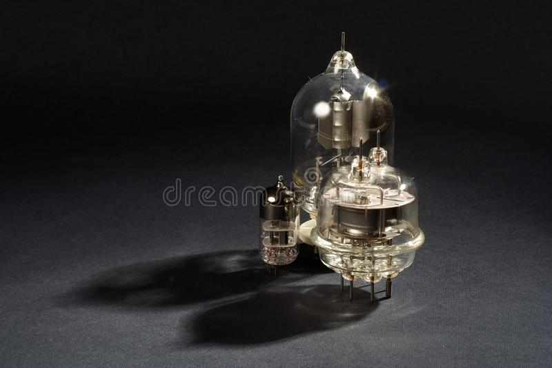 Old vacuum tubes on black. Background stock photography