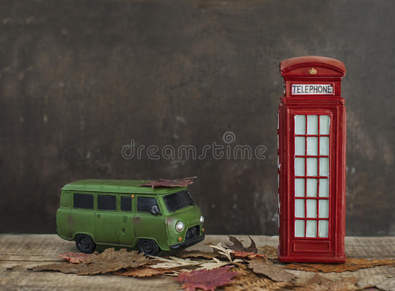 Old van and vintage red phone booth stock photo