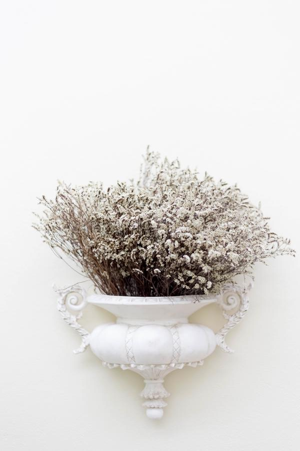 Old vase with dried flowers stock photo