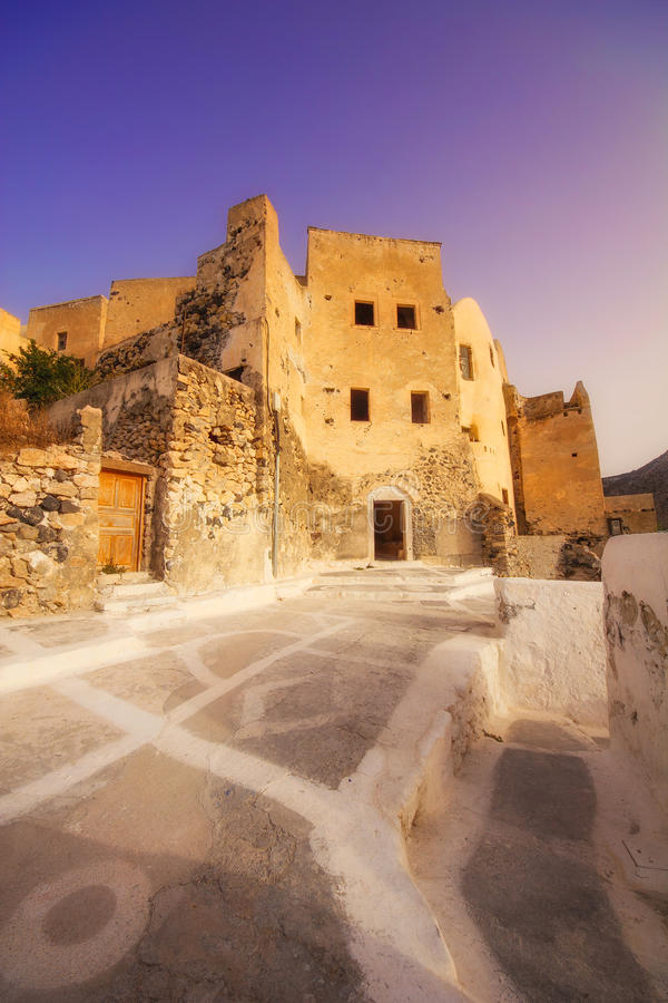 The old Venetian castle ruins in Emporio village at dawn. Santorini island, Greece royalty free stock photo